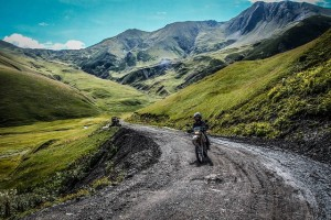 motorcyclist in mountains